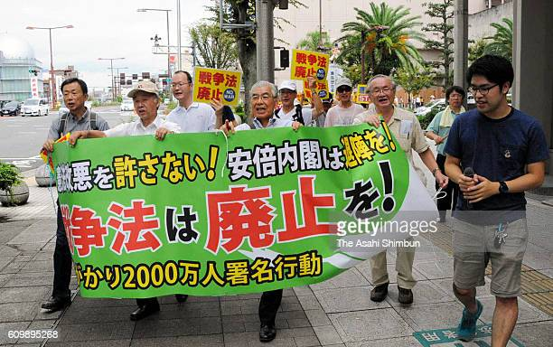 Anti national security legislation laws protesters march on during a rally on September 19 2016 in Tsu Mie Japan People express their continued...