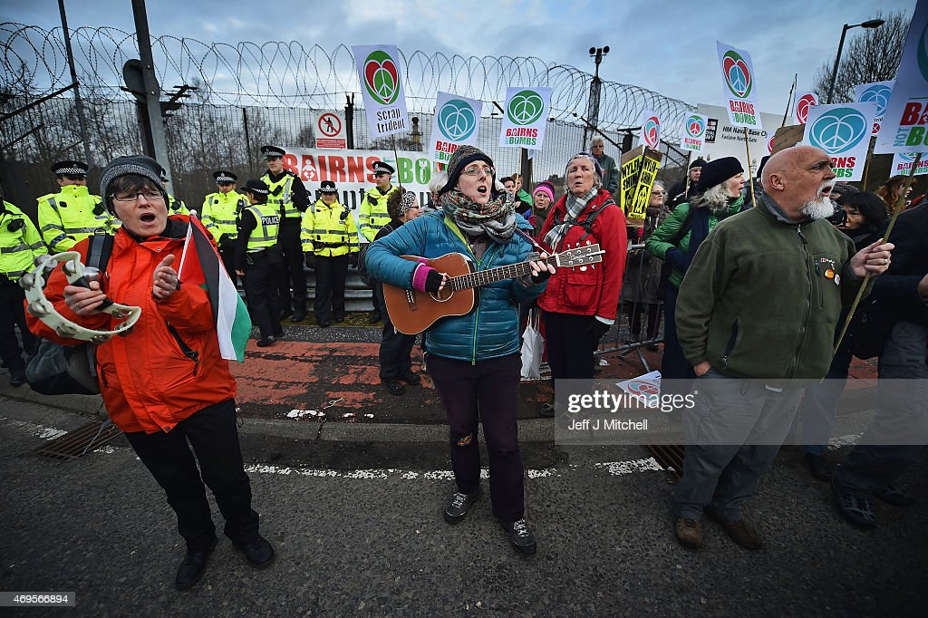 Anti nuclear activists block one of the entrances to Faslane naval base on the Clyde on April 13, 2015 in Faslane,Scotland. The protest is taking place just weeks before the general election, in which the issue of Trident is likely to play a key role. The Scrap Trident campaign is urging voters to back only those candidates who firmly reject the plan to replace the current Trident system.