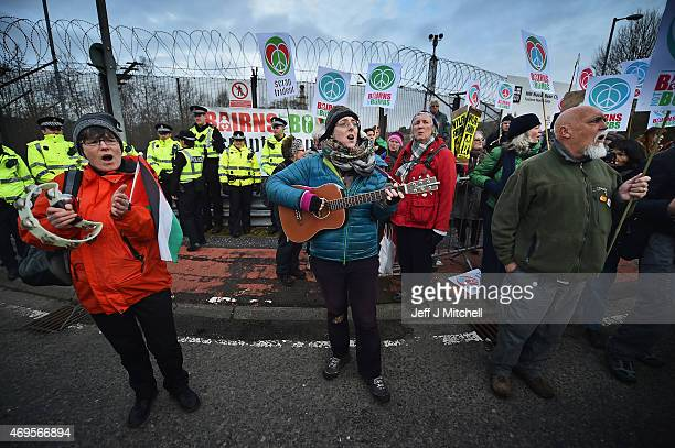 Anti nuclear activists block one of the entrances to Faslane naval base on the Clyde on April 13 2015 in FaslaneScotland The protest is taking place...