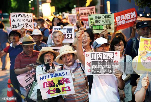 Anti nuclear protesters hold a rally in front of the Prime Minister Shinzo Abe's official residence as the Kyushu Electric Power Co activated the No...