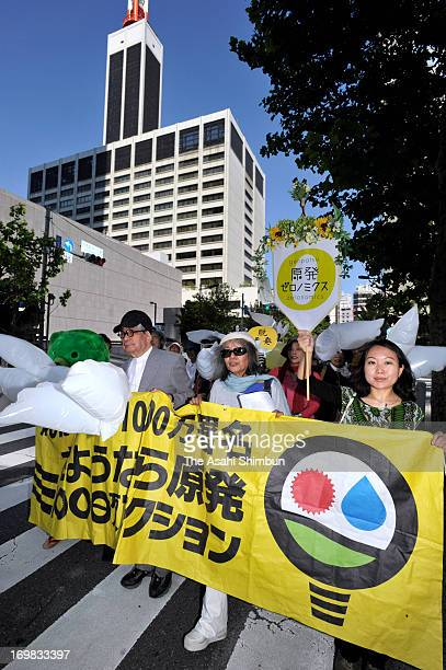 Anti nuclear protesters including authors Kenzaburo Oe and Keiko Ochiai walk in front of the Tokyo Electric Power Co headquarters on June 2 2013 in...