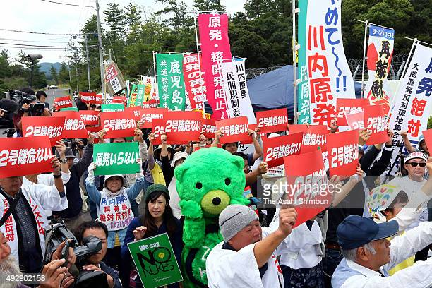 Anti nuclear protesters stage a demonstration as the Kyushu Electric Power Co restarts the No2 reactor of the Sendai Nuclear Power Plant on October...