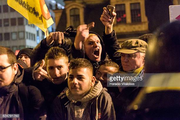 Anti Pegida demonstrators protest against some 50 pro Pegida participants who gathered surrounded by hundreds of police officers and more than 1000...