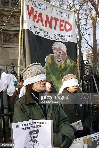 Anti Pinochet supporters continue to demonstrate outside the House of Lords 21 January in London as Amnesty International where due back in the House...