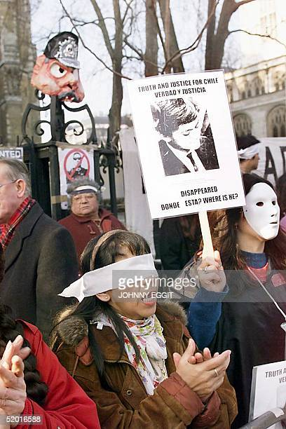 Anti Pinochet supporters continue to demonstrate outside the House of Lords 21 January in London, as Amnesty International where due back in the...