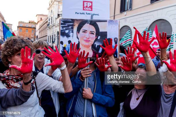 Anti racist people with hands marked red to symbolise the blood with the photo of Hevrin Khalaf, activist for women's rights, Secretary General of...