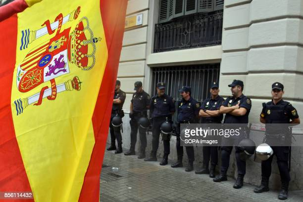 Anti referendum Spanish nationalist shows a national flag in front of the police About 5500 according to the Guardia Urbana and 15000 according to...