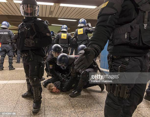 Anti Riot Police detain an anti Pegida demonstrator at the end of a pro Pegida meeting in Hauptwache square Frankfurt Germany 09 February 2015 some...