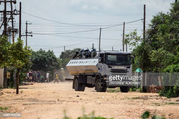 Anti riot police stands on a truckload engaging in running battles with protestors in Emakhandeni township Bulawayo Zimbabwe on January 15 2019 The...