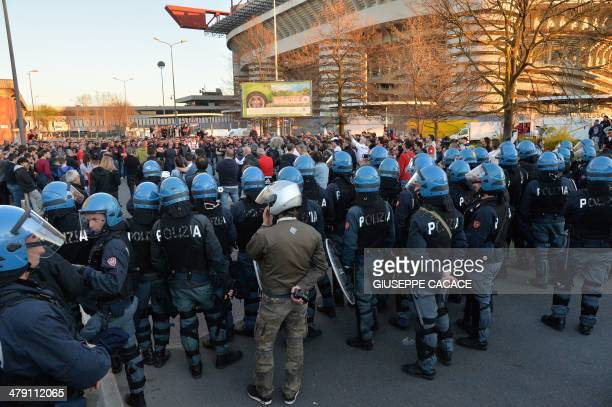 Anti riot policemen stand outside the San Siro stadium after the Serie A football match between AC Milan and Parma in Milan on March 16 2014 AFP...