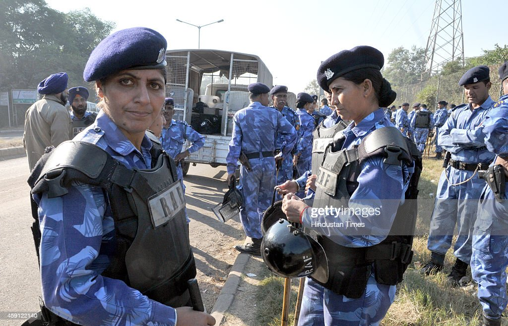 Anti riot squad of Chandigarh Police stand outside Chandigarh railway station to check the entry of followers of godman Rampal into city on November..