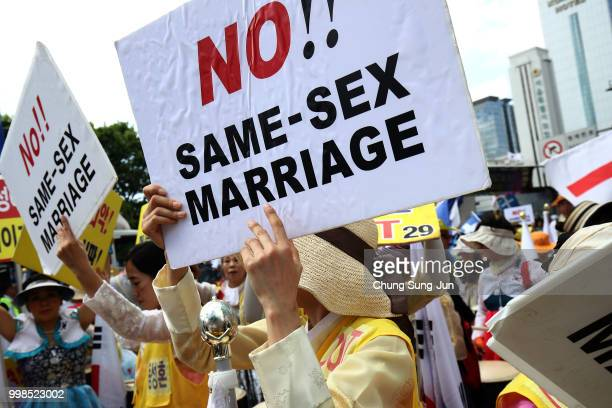 Anti samesex marriage activists attend the rally next to the Korea Queer Culture Festival 2018 in front of City hall on July 14 2018 in Seoul South...