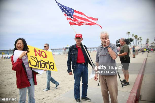 Anti Shariah Law supporters stand along the Strand during the March For Human rights and Against Sharia law demonstration in Oceanside California on...