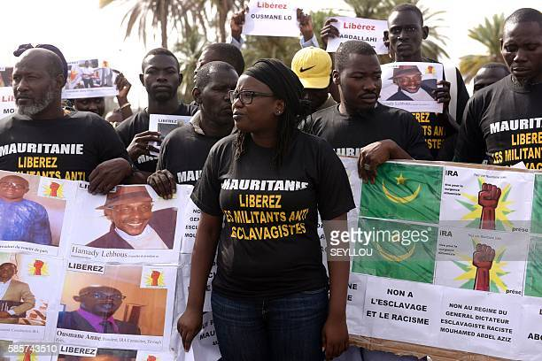 Anti slavery militants hold a banner which translates as No to slavery and racism no to the regime of the general dictator slavery racist Mouhamed...
