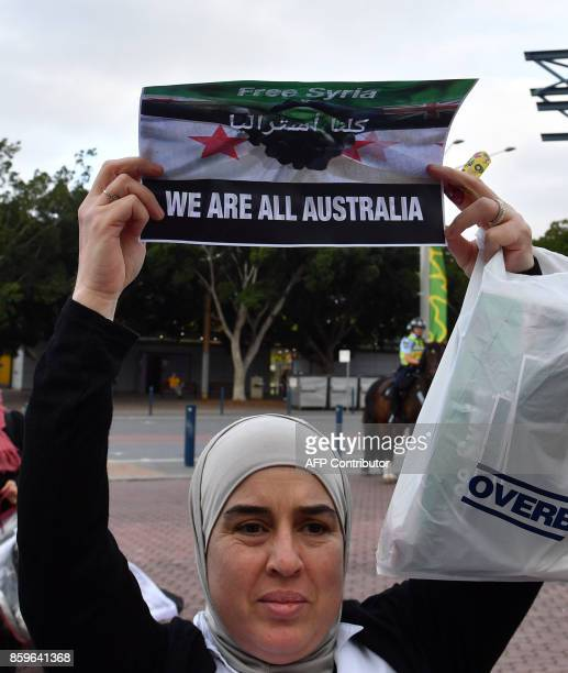 Anti Syrian President Bashar alAssad protestors shouts outside the stadium prior to 2018 World Cup football qualifying match between Australia and...