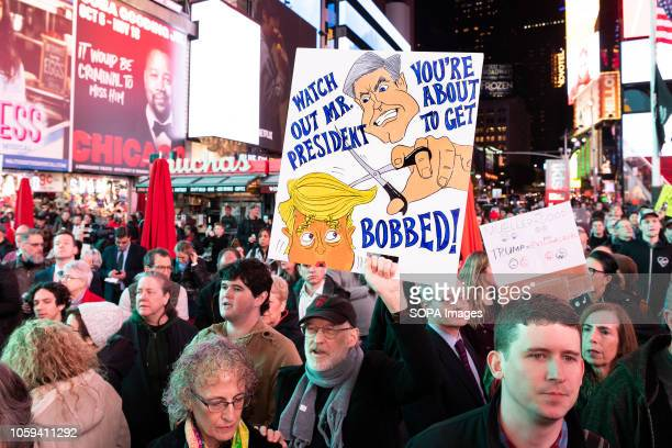 Anti Trump placard seen during the rally Thousands took to Times Square of New York City during a rally to support Robert Mueller's investigation...