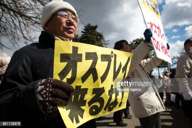 Anti US Base protesters are seen in front of the gate of JGSDF Camp Soumagahara during a joint training drill of US Marines and Japan's Ground Self...