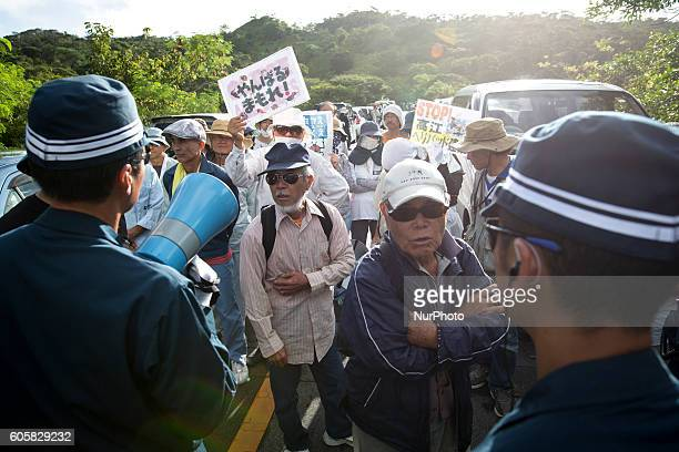 Anti US base protesters confront with police as they stand to stop the construction of helipads near the gate of US military's Northern Training Area...