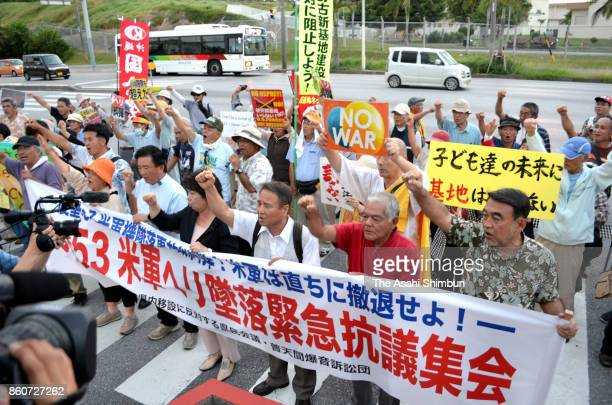Anti US base protesters hold a rally after the US Ch53 transport helicopter crash at a farm land at Camp Zukeran on October 12 2017 in Kitanakagusuku...