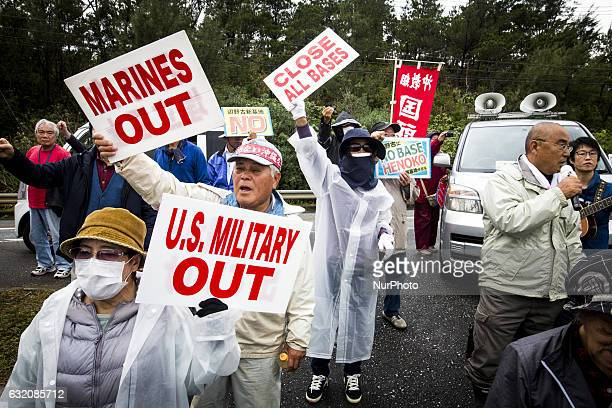 Anti US Base protesters shout with their placards to protest against the relocation of the new US Marine Airbase construction in Oura Bay Camp Schwab...