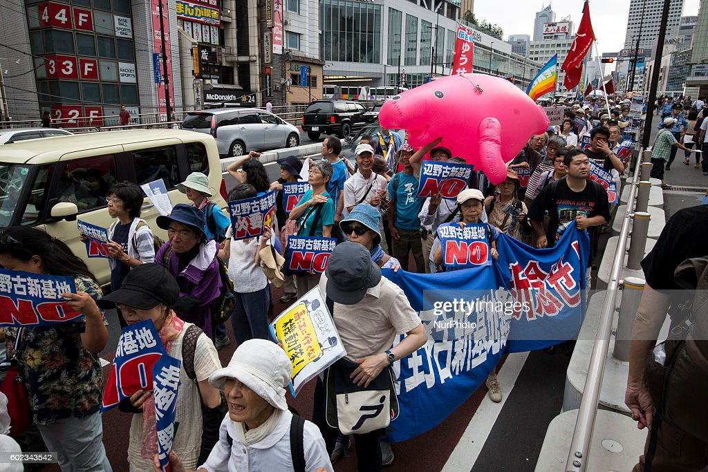 Anti U.S base protesters stage a rally in Tokyo against U.S. helipad construction in the village of Higashi in Okinawa, September 11, 2016. Japanese government resume construction of total six helipads amid protests in a fragile ten million year old Yanbaru forest that is home to endemic endangered species such as the Okinawan rail and Okinawa wood pecker.