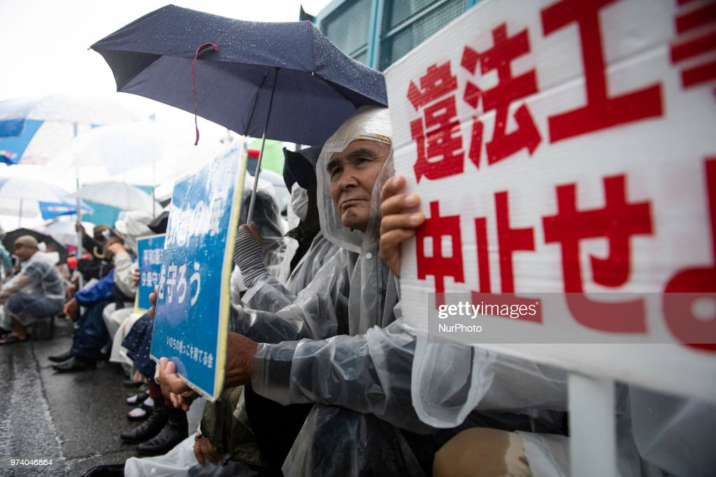 Anti U.S. Base protesters stage a rally outside the U.S Base Camp Schwab on June 14, 2018 in Nago, Okinawa prefecture, Japan. Protesters stage a sit-in protest at the gate of the U.S. Marine Corps' Camp Schwab in the Henoko district of Nago blocking the passage of construction vehicles mobilized by the Japanese government for the relocation of the on-going construction of the new U.S Marines Airbase Station in Futenma.