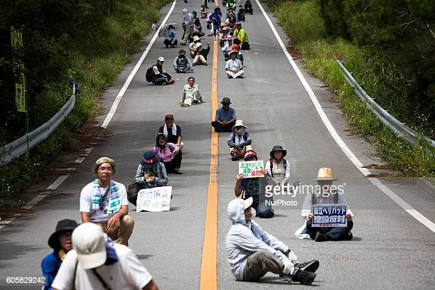 Anti US base protesters staged a sit in protest blocking the road to protest against the construction of helipads near the gate of US military's...