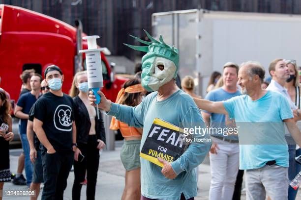 Anti- vaccination activists protest the proof of vaccination requirement to get into the Foo Fighters show as Madison Square Garden reopens with the...