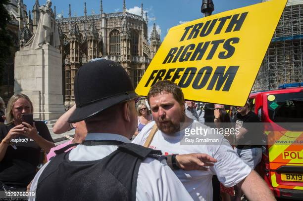 Anti Vaxxers argue with police after disrupting a photo call by NHS workers demanding better pay on July 20, 2021 in London, England.