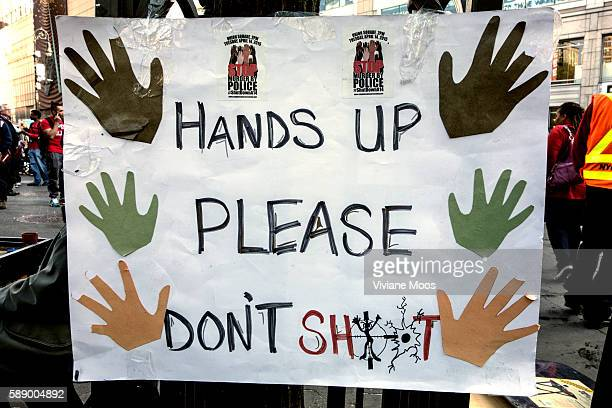 Anti violence anti police brutality anti racism political and social protest in Union Square New York City May 1 2015 Hands Up Please don't shoot...