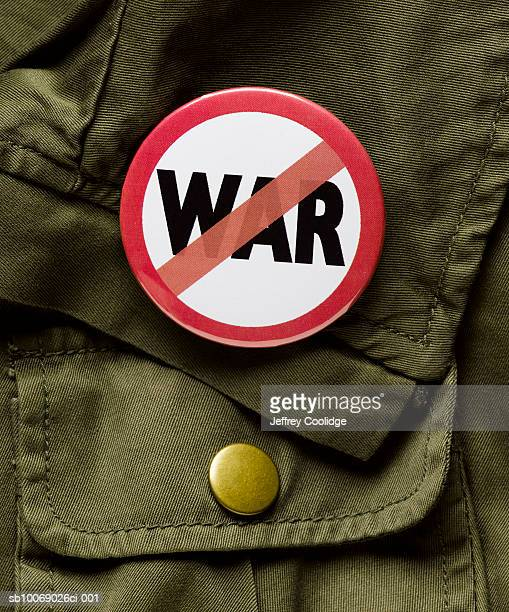 anti war button on pocket, close-up - peace demonstration stock photos and pictures
