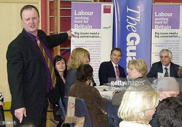 Anti war campaigner Michael Start accuses the Prime Minister Tony Blair of being a war criminal, during a meeting at a primary school in Enfield,...