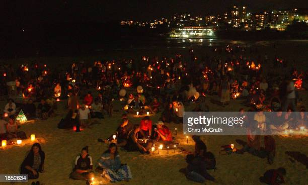 Anti War protesters gather at Bondi Beach, Sydney to hold a candlelight vigil, March 16, 2003 in Sydney, Australia. Locals from the beachside...