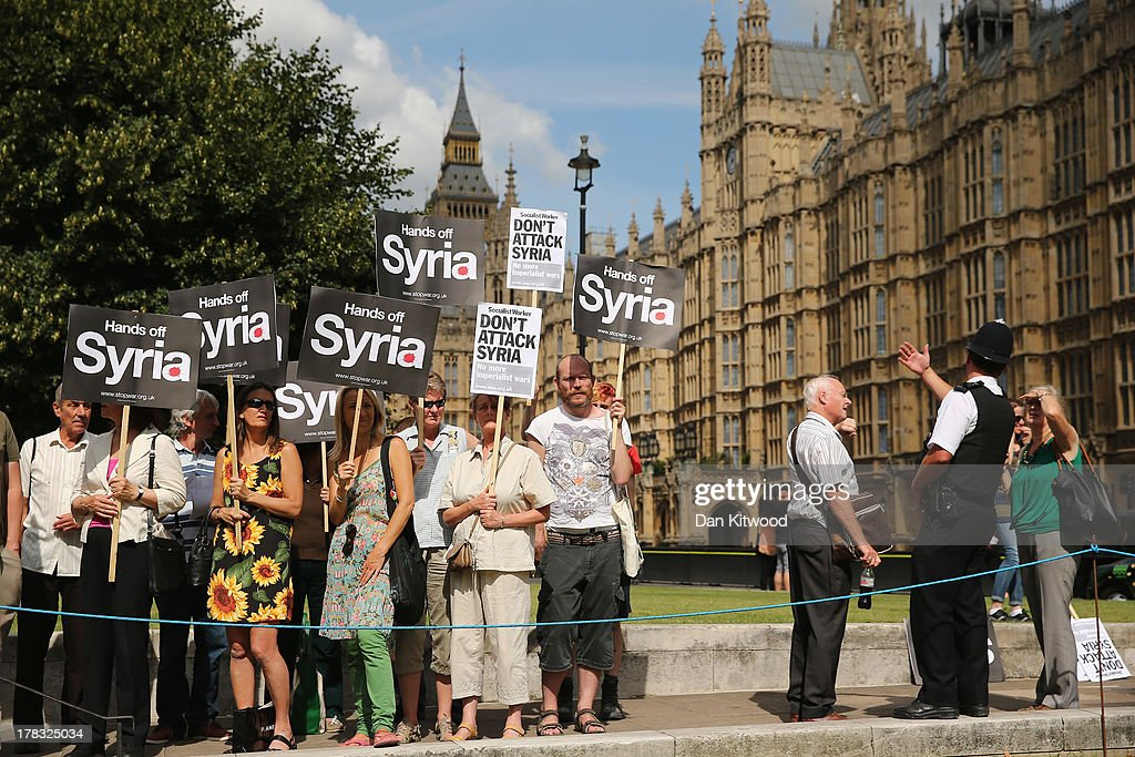 Anti war protesters gather on College Green outside the Houses of Parliament on August 29, 2013 in London, England. Prime Minister David Cameron has recalled Parliament's to debate the UK's response to a suspected chemical weapon attack in Syria.
