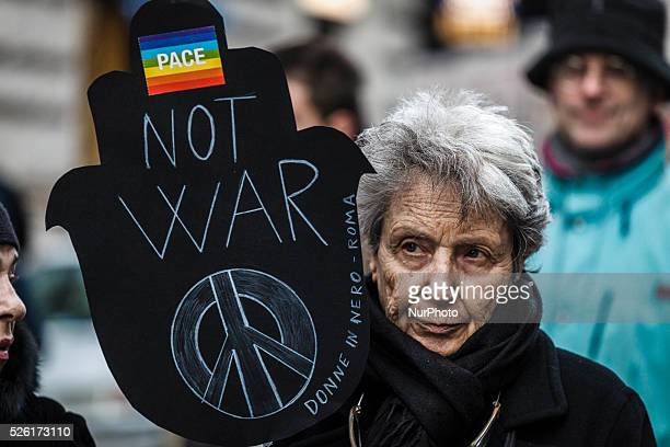 Anti war protesters hold banners and wave flags to say 'Stop the War' as they take part in a demonstration against the war in Rome Italy Thousands of...
