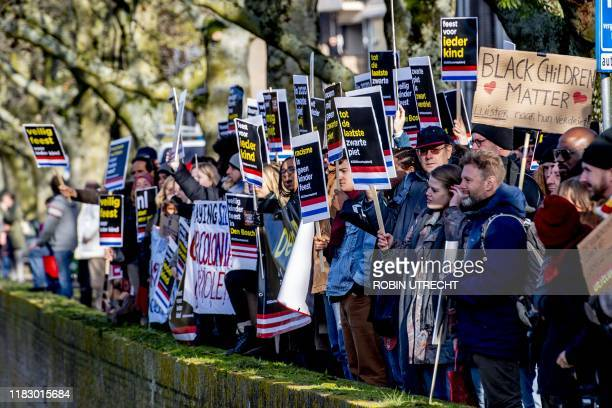 Anti Zwarte Piet protesters hold placards at the arrival of Sinterklaas, a traditionally annual event in the Netherlands on November 17, 2019 in...
