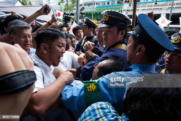 Anti-Abe protesters clash with Japanese police during the speech of Japanese Prime Minister Shinzo Abe for his candidate Aya Nakamura of main...