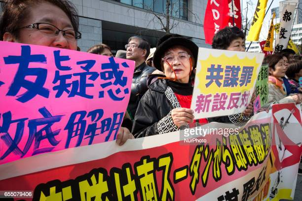 AntiAbe protesters gather with placards and banners in front of Tokyo parliament during a rally denouncing his government policies and calling on the...