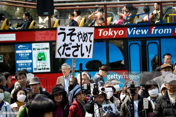 AntiAbe protesters gather with placards in front of Tokyo parliament during a rally denouncing his government policies and calling on the Japanese...