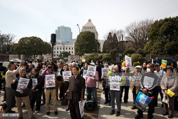 AntiAbe protesters with placards gather in front of the National Diet Building to protest against the policies of Shinzo Abe and to call on the...