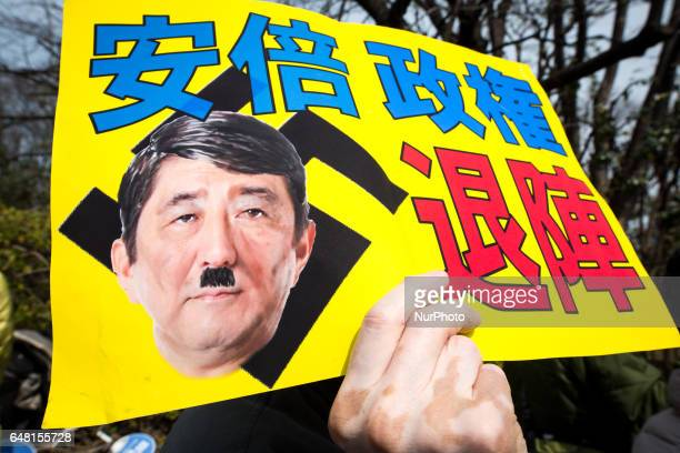 AntiAbe protesters with placards reading quotAbe government leave outquot gather in front of the National Diet Building to protest against the...