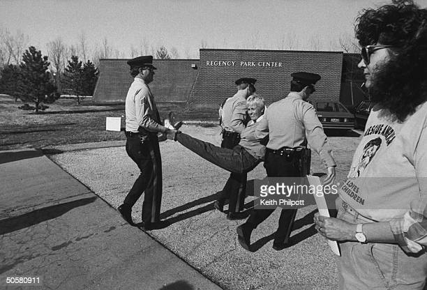 Antiabortion activist Carol Armstrong being carried by 3 unident police officers when the group she works w The ProLife Direct Action League...