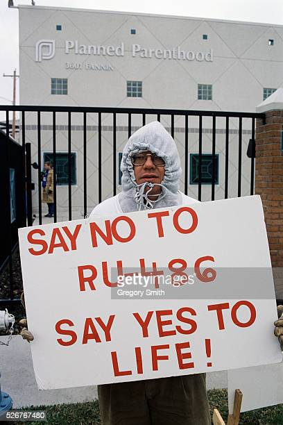 Antiabortion activist William Burban holds a sign protesting RU486 outside of a Planned Parenthood clinic in Houston Texas RU486 the abortion pill is...