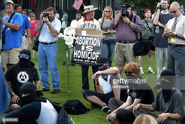 Antiabortion activists as well as G8 protesters gather to demonstrate against the G8 Summit June 8 2004 in Savannah Georgia The G8 Summit brings...