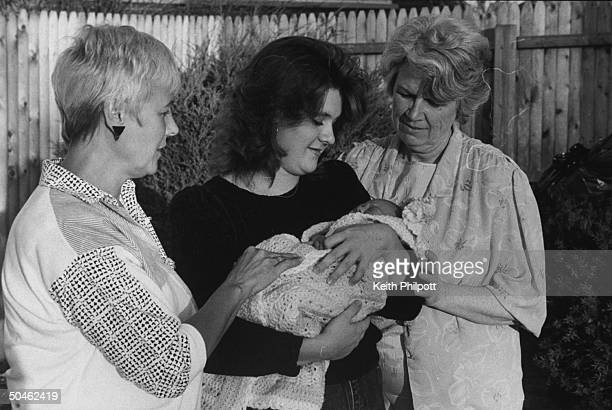 Antiabortion activists Carol Armstrong Anne O'Brien looking on as Stacey Feit cradles her 7 day old son Zachary