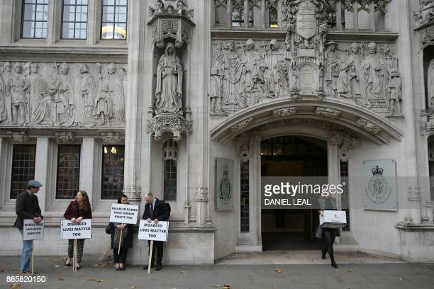 Antiabortion activists demonstrate outside the the Supreme Court in central London on October 24 2017 where a case on the abortion regime in Northern...