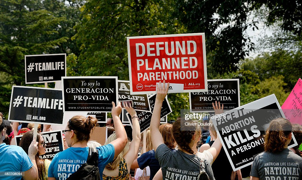 Anti-abortion activists hold a rally opposing federal funding for Planned Parenthood in front of the U.S. Capitol on July 28, 2015 in Washington, DC. Sen. Rand Paul (R-KY) announced a Senate deal to vote on legislation to defund Planned Parenthood before the Senate goes into recess in August.
