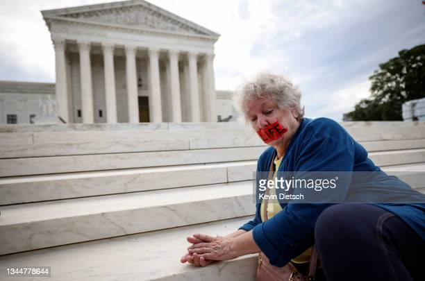 Anti-abortion activists pray on the steps of the Supreme Court on October 04, 2021 in Washington, DC. The Supreme Court's new term, which started...
