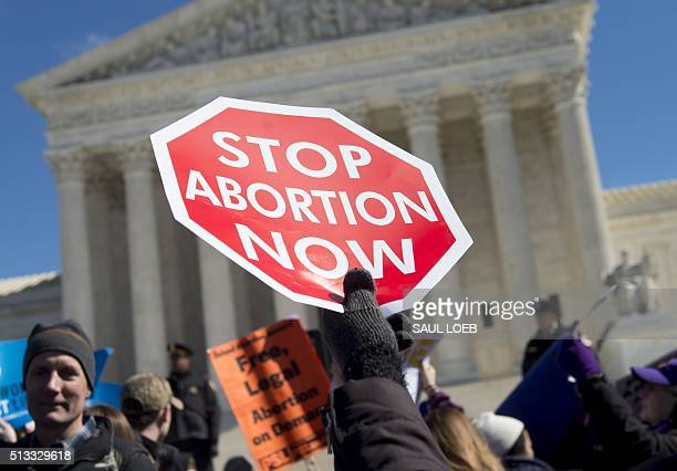 Antiabortion activists rally outside of the Supreme Court in Washington DC March 2 following oral arguments in the case of Whole Woman's Health v...