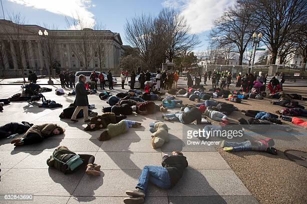 Antiabortion advocates participate in a 'diein' demonstration on Pennsylvania Avenue near the White House January 27 2017 in Washington DC This year...